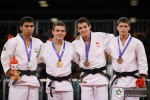 David Pulkrabek (CZE), Mansurkhuja Muminkhujaev (UZB), Pedro Rivadulla (ESP), Dmytro Atanov (UKR) - Youth Olympic Games Singapore (2010, SIN) - © IJF Media Team, International Judo Federation